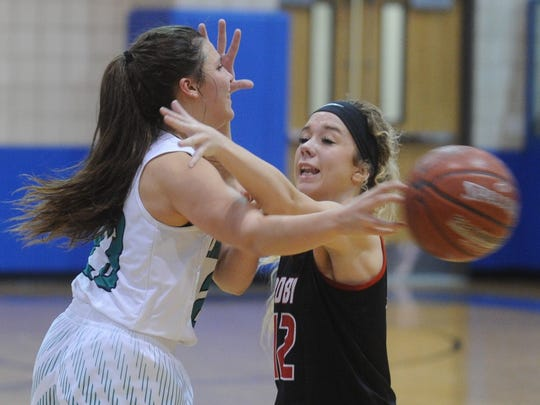 May's Roberta Robinette, left, passes the ball while Roby's Kolbi Helm defends. May beat the Lady Lions 48-41 in the Region II-1A quarterfinal playoff game Tuesday, Feb. 20, 2018 in Winters.