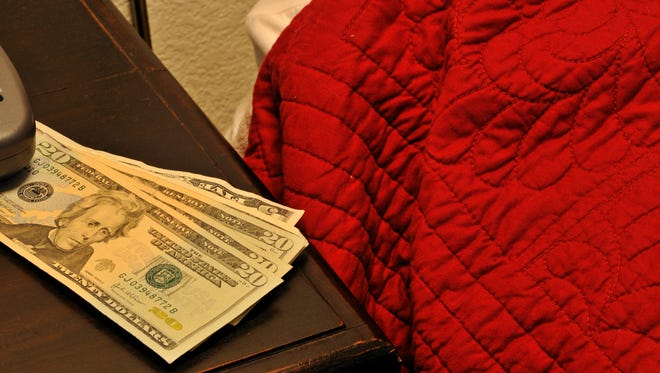 Stock image: Money on the bed