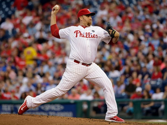 Philadelphia Phillies' Aaron Harang pitches during the third inning of a baseball game against the Philadelphia Phillies, Saturday, May 9, 2015, in Philadelphia. (AP Photo/Matt Slocum)