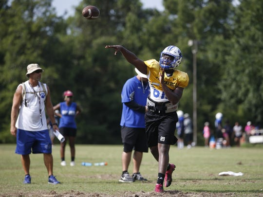 Godby senior quarterback Darius Bradwell, a Kent State commit, works out with his team during a fall practice at the high school on Friday, Aug. 7, 2015.