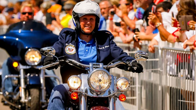 Vice President Mike Pence rides a motorcycle in with Sen. Joni Ernst at her Roast and Ride Friday, June 3, 2017, near Boone, Iowa. She rode into the expo center with over 300 motorcycle riders including the VP.