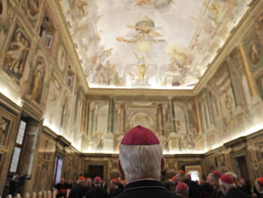 A cardinal attends Pope Francis' message to prelates