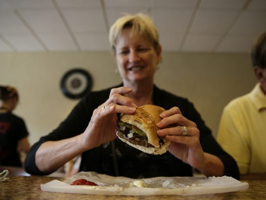 Sue Diehl takes a look at her sandwich before her first