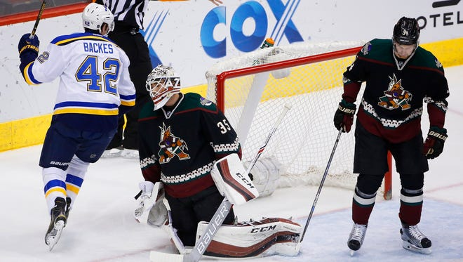 St. Louis Blues' David Backes (42) celebrates a goal by teammate Alexander Steen against Arizona Coyotes goalie Louis Domingue (35) as Coyotes' Klas Dahlbeck (34) skates past during the first period of an NHL hockey game Saturday, Feb. 20, 2016, in Glendale, Ariz.
