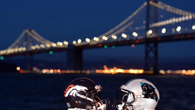 Helmets for the Denver Broncos and Carolina Panthers are lined up in front of the Bay Bridge prior to Super Bowl 50 between the Carolina Panthers and the Denver Broncos.