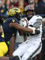 Michigan's Rashan Gary sacks Ohio State's J.T. Barrett in the first quarter of the Wolverines' 31-20 loss Saturday, Nov. 25, 2017 at Michigan Stadium.