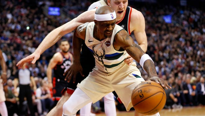 Milwaukee Bucks guard Jason Terry (3) battles Toronto Raptors center Jakob Poeltl (42) for the ball at the Air Canada Centre. Milwaukee defeated Toronto in overtime.