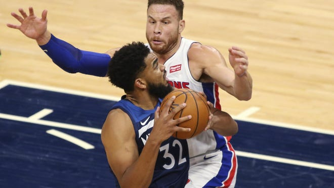 Minnesota Timberwolves forward Karl-Anthony Towns (32) drives on Detroit Pistons forward Blake Griffin (23) during the second quarter of an NBA basketball game, Wednesday, Dec. 23, 2020 in Minneapolis.