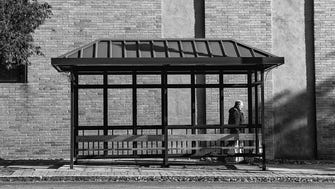 A man walks past a bus stop on Palisade Avenue in Englewood on Nov. 10, 2017.