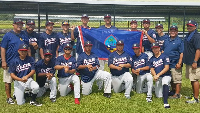 The Guam Senior Little League All-Stars show their island pride before the start of their game against Hong Kong July 3 in Manila at the Asia-Pacific Regional Championships. They are pictured with manager Eugene McDonald, head coach Gene Mendiola and assistant coach Jess Lizama.