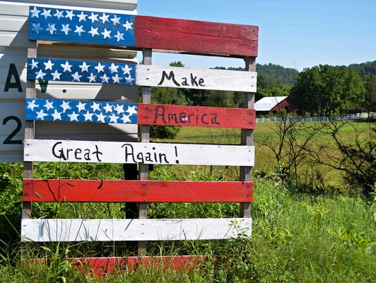 This handmade sign, made from a wooden pallet, declares