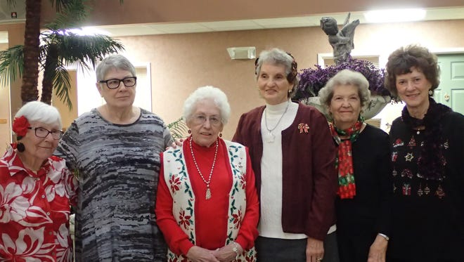 Past presidents celebrate the 60th anniversary of the Rainbow Garden Club, including Lucille Johnson, Sharon Winchell, Ivy Jackson, Kathy Austin, Virginia Piatt and Verna Kessner.