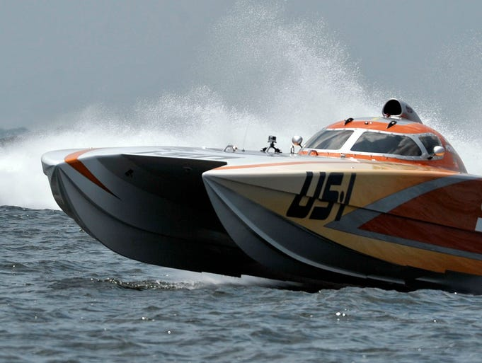 Power boats involved in the Pensacola Grand Prix inaugural power boat race compete Sunday on Pensacola Bay.