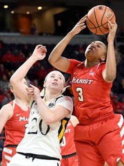 Quinnipiac forward Paige Warfel defends against Marist