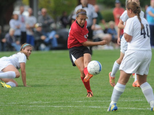 Dover's Brooke Firestone takes a shot on goal during an Eagles victory at West York during the 2013 campaign.