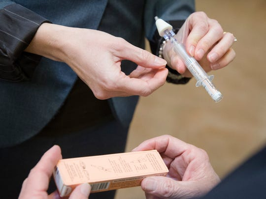 A naloxone nasal injector is demonstrated.