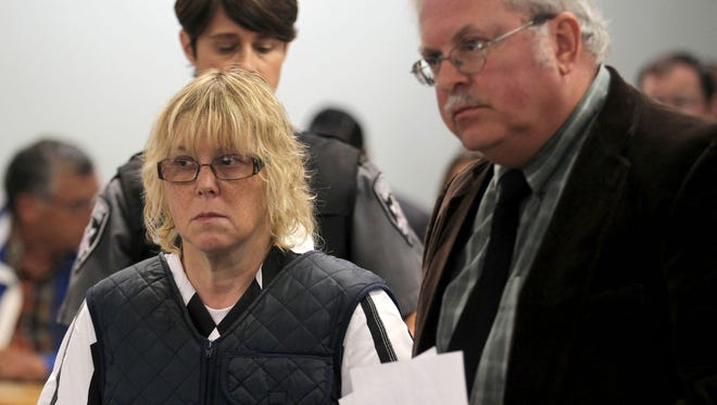 Joyce Mitchell stands with her lawyer Steven Johnston in Plattsburgh City Court on June 15, 2015.