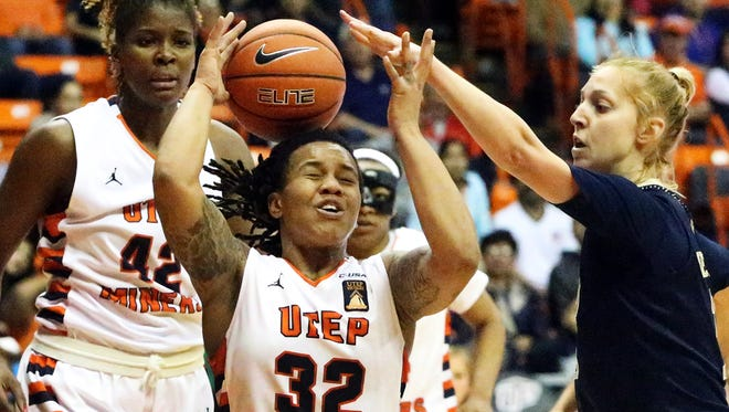 UTEP's Chrishauna Parker, 32, battles for an offensive rebound against Janka Hegedus, right, of FIU on Thursday night in the Don Haskins Center. The Miners prevailed 70-52. At left is UTEP forward Tamara Seda, 42.