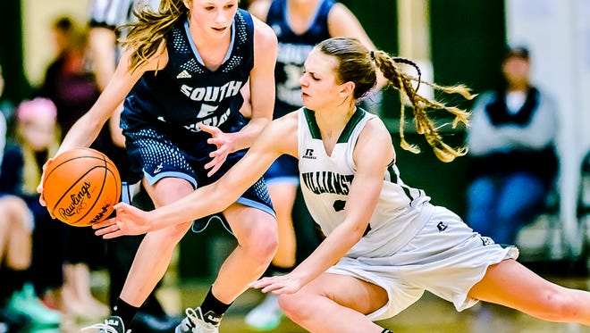 Renee Sturm, right, of Williamston knocks the ball away from Mariel Bruxvoort of Grand Rapids South Christian on a steal attempt in the 4th quarter of their Class B regional semifinal game Tuesday March 8, 2016 at Wayland Union High in Wayland.  Sturm, a three-sport athlete her senior year, has been named the State Journal female athlete of the year.