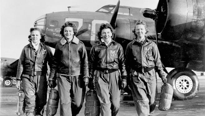"""In this historical photo, Frances Green, Margaret (Peg) Kirchner, Ann Waldner and Blanche Osborn leave their plane, """"Pistol Packin' Mama,"""" at the four-engine school at Lockbourne AAF, Ohio, during WASP ferry training B-17 Flying Fortress."""