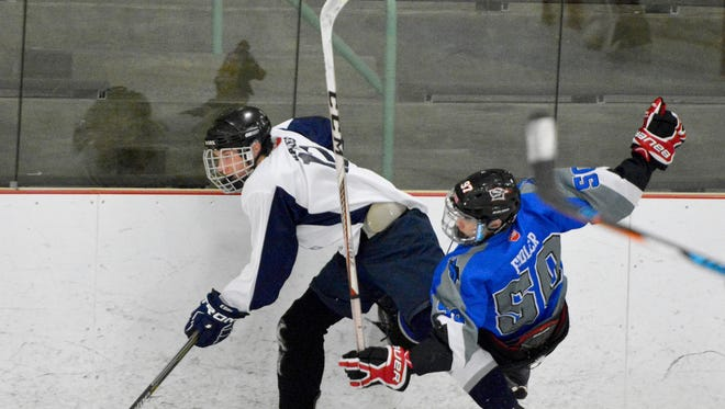 Dallastown's Tanner Haines, left, had a goal and an assist on Monday vs. the Shamrocks. YORK DISPATCH FILE PHOTO