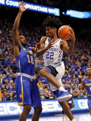 Kentucky Wildcats guard Shai Gilgeous-Alexander (22) shoots the ball against Morehead State Eagles forward Alonzo Chatman (10) in the first half at Rupp Arena.