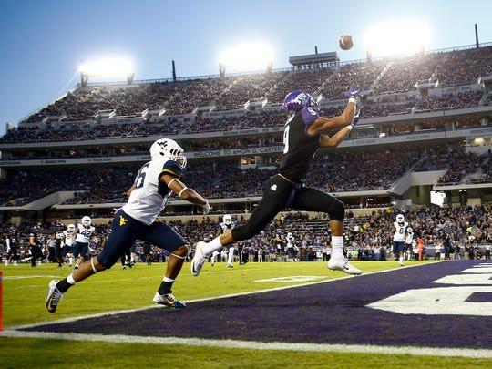 TCU wide receiver Josh Doctson catches a touchdown pass against West Virginia.