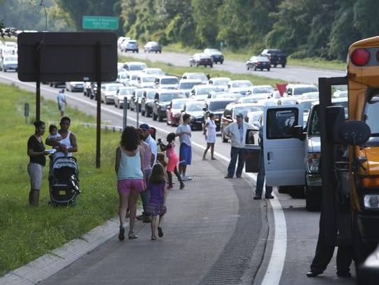 Motorists stuck in traffic at the scene of a fatal