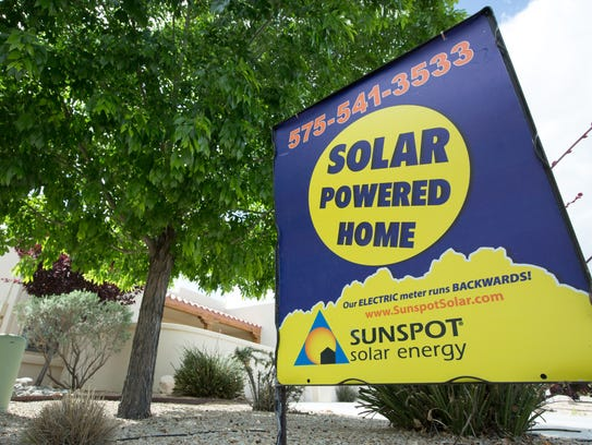 A Sunspot Solar Energy sign is posted in front of a