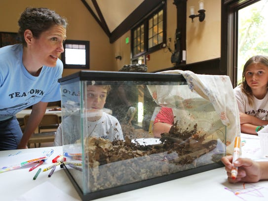 Camp director Lisa Baugh talks with the junior naturalist