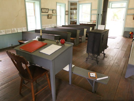 Long bench-style desks and other classroom furniture