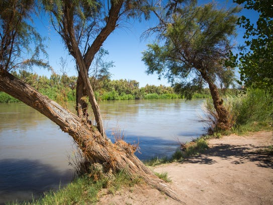 Water flows down the Rio Grande on the banks of the