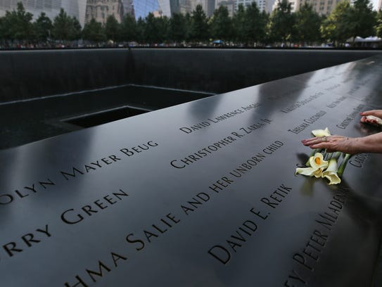 A visitor to the National September 11 Memorial arranges