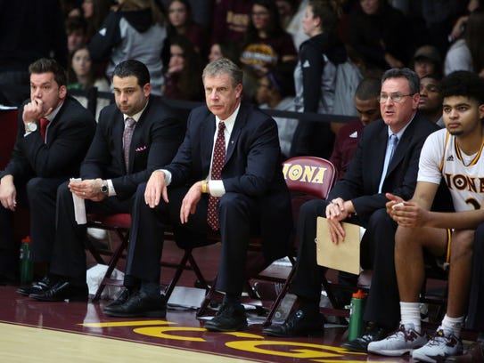 Iona College head coach Tim Cluess, center, is pictured