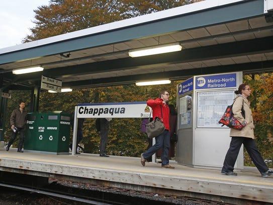 Commuters hurry along the Metro-North Chappaqua Train