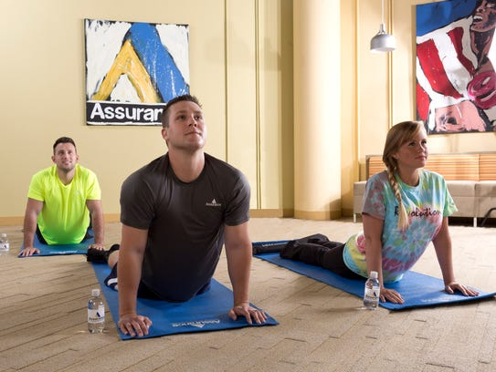 Assurance employees participate in an onsite wellness