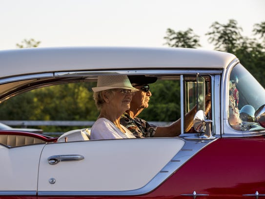 A couple cruises together during Cruise Night on Pine