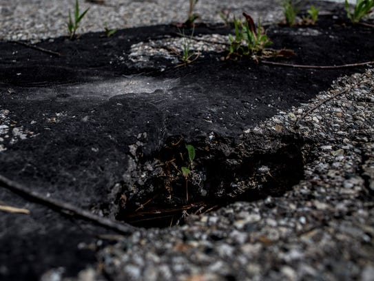 A hole is seen on the surface of the St. Clair Highway