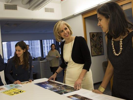 Time magazine then-managing editor Nancy Gibbs (center,