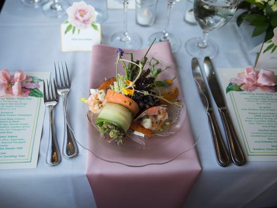 A vegetable and prawn salad sits on a wedding table