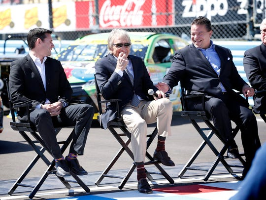 Watkins Glen International President Michael Printup, right, shares a moment with Andy Lally, left, and Derek Bell last year during a ceremony to commemorate the repave of the road course.
