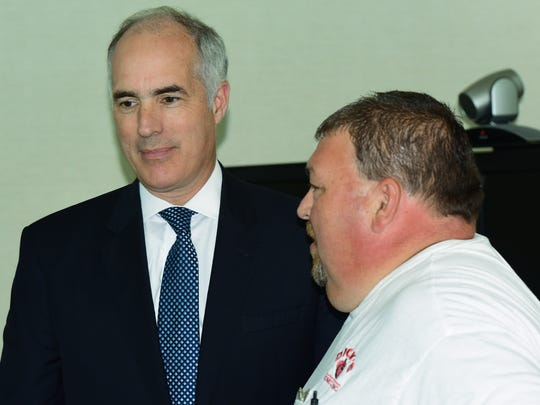 U.S. Senator Bob Casey, left,  (D-PA) visits with recovering cancer patient Mike Newell at the Fulton County Medical Center to discuss the GOP health care bill effect on the rural American town on Monday, July 24, 2017.