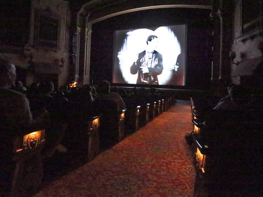 The audience views silent short films Thursday in the Plaza Theatre.