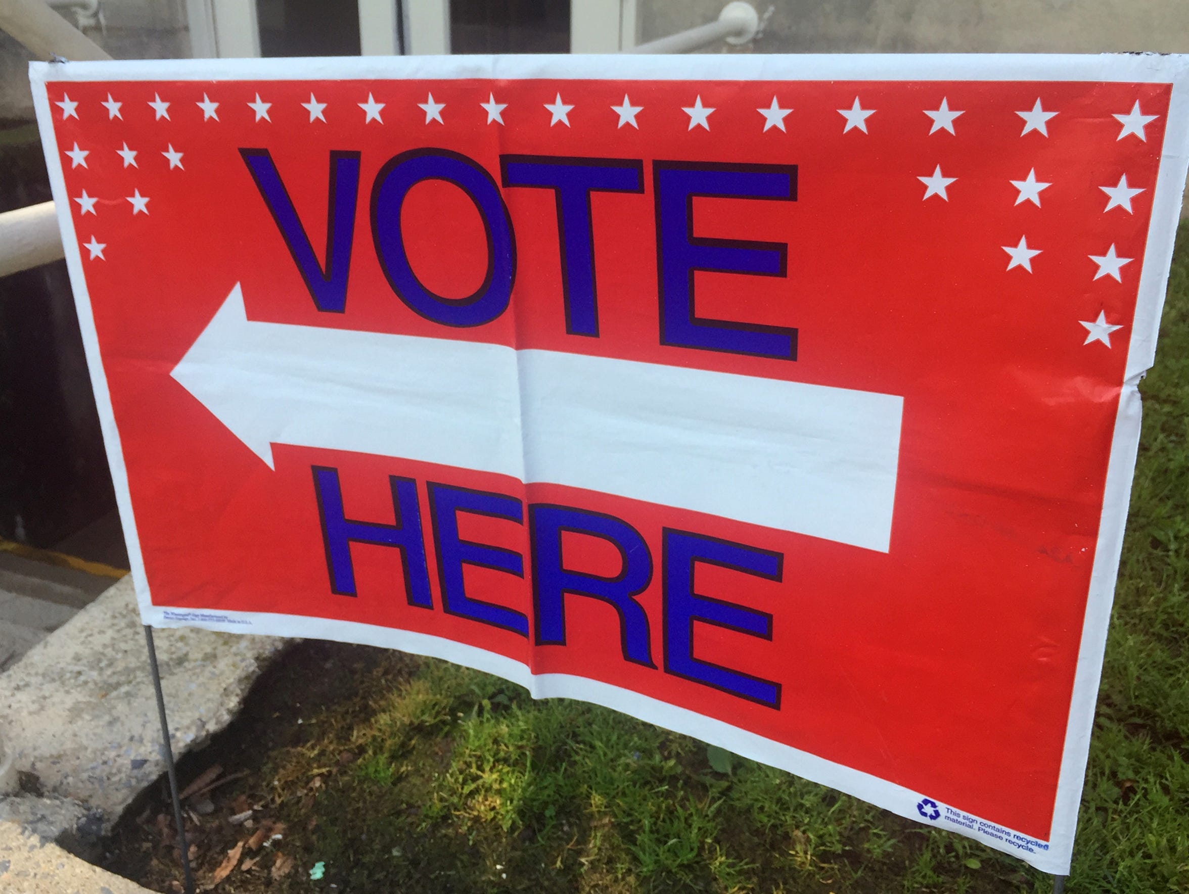 A sign directs voters to a polling place on primary election day on Tuesday, May 15, 2018.