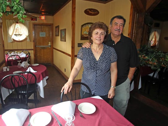 Tony and Maria Dos Reis are photographed at their restaurant