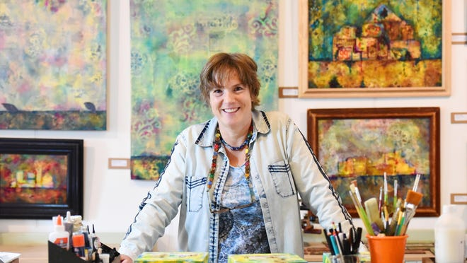 Suzanne Woolf stands inside her home studio in Greenville.