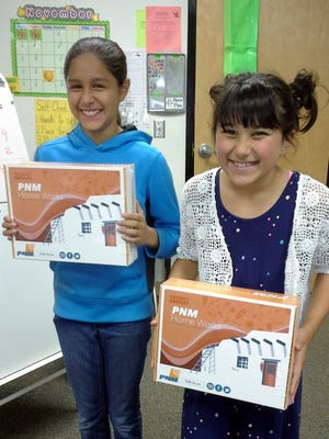 Chaparral fifth graders Aubrey Holguin and Zoey Dominguez received a Think! Energy Kit from PNM after the presentation.