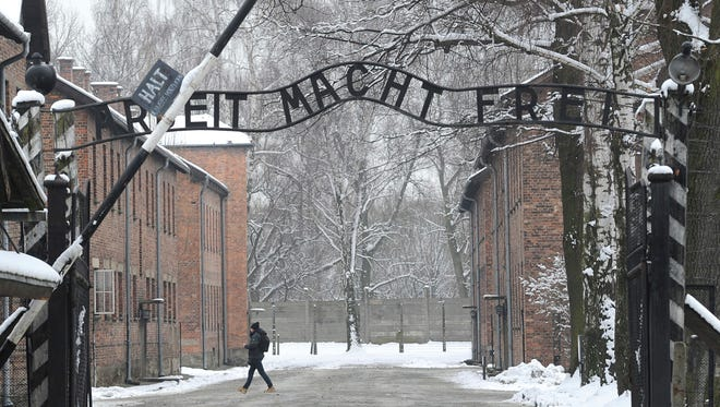 "This Jan. 26, 2015 file photo shows the entrance to the former Nazi Death Camp Auschwitz with the ""Arbeit Macht Frei"" (Work Sets you Free) writing above, in Oswiecim, Poland."