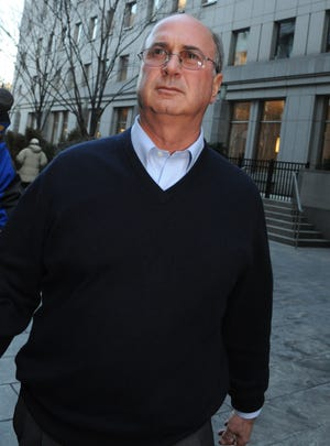 Stephen Walsh leaves Manhattan federal court after being released on bail Feb 25, 2009, in New York.