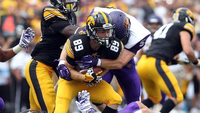 Northern Iowa linebacker Blake Wilson tackles Iowa receiver Matt VandeBerg Saturday at Kinnick Stadium during the Hawkeyes' 31-23 win.